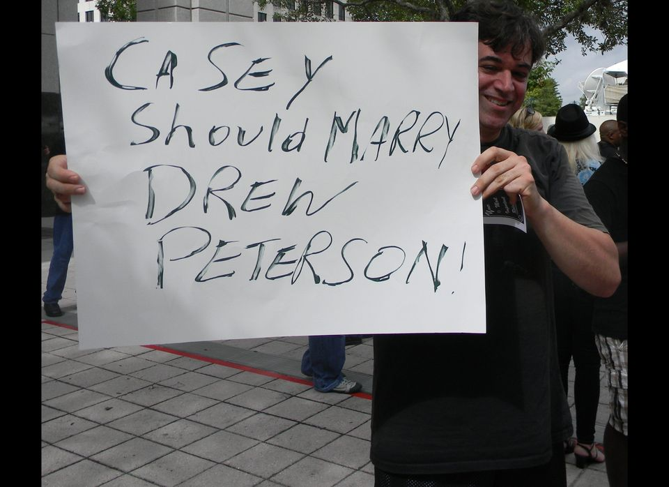 A man holds a sign outside the Orange County Court House in Orlando, Fla., in July 2011, on the day Casey Anthony appeared in