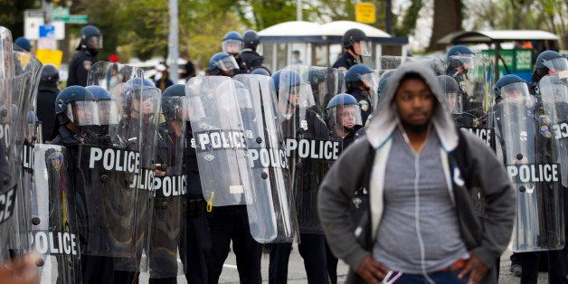 Baltimore police officers push back demonstrators after the funeral of Freddie Gray, Monday, April 27, 2015, in Baltimore. Gr