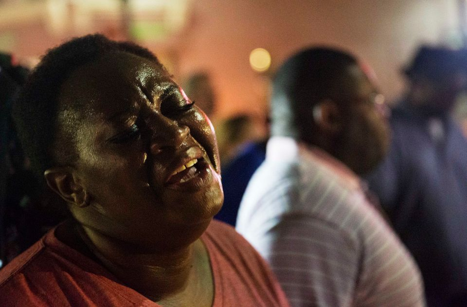 Lisa Doctor joins a prayer circle down the street from the Emanuel AME Church early Thursday, June 18, 2015 following a shoot