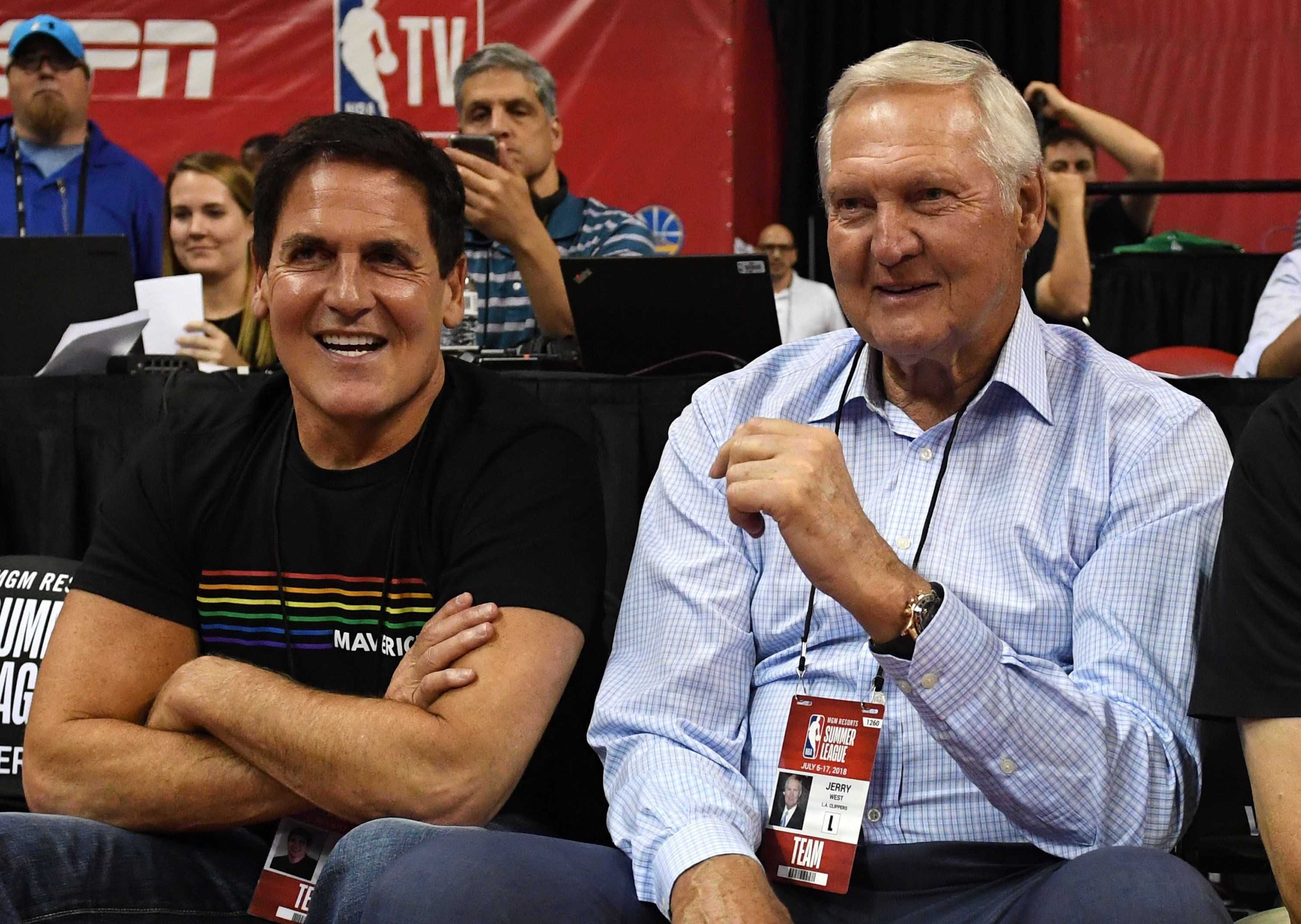 LAS VEGAS, NV - JULY 06:  Dallas Mavericks owner Mark Cuban (L) and Los Angeles Clippers executive board member Jerry West talk as they watch a 2018 NBA Summer League game between the Mavericks and the Phoenix Suns at the Thomas & Mack Center on July 6, 2018 in Las Vegas, Nevada. The Suns defeated the Mavericks 92-85. NOTE TO USER: User expressly acknowledges and agrees that, by downloading and or using this photograph, User is consenting to the terms and conditions of the Getty Images License Agreement.  (Photo by Ethan Miller/Getty Images)