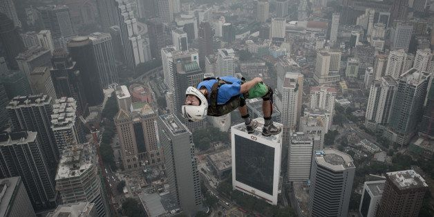 Base jumper Denis Odintsov from Russian leaps from the 300-metres Open Deck of the Malaysia's landmark Kuala Lumpur Tower dur