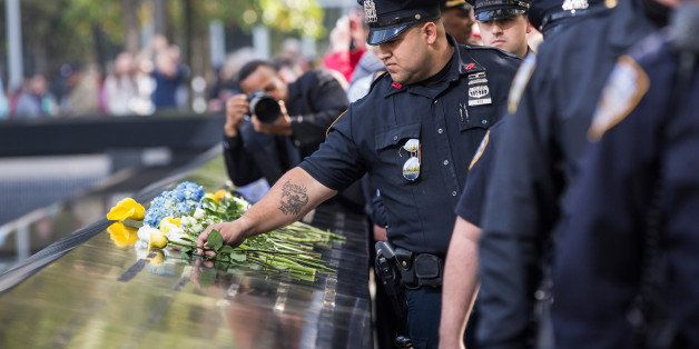 NEW YORK, NY - OCTOBER 22:  Law enforcement officials lay flowers in tribute to slain New York Police Department officer Rand