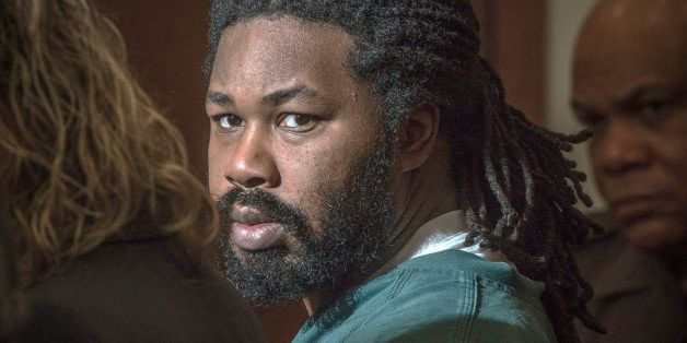 FILE - In this Nov. 14, 2014 file-pool photo, Jesse Matthew, right, looks toward the gallery while appearing in court in Fair