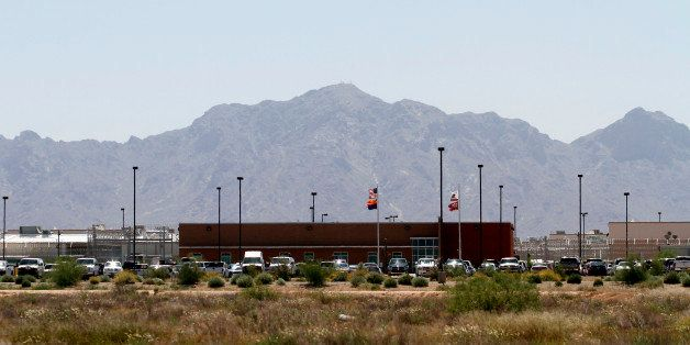 Vehicles are parked outside the La Palma Correctional Center in Eloy, Arizona, U.S., on Tuesday, May 11, 2010. La Palma, whic