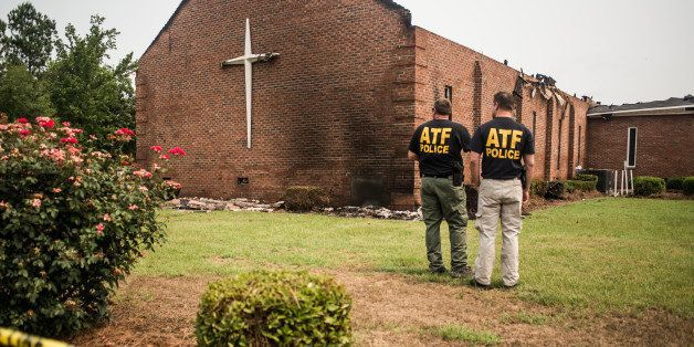 GREELEYVILLE, SC - JULY 1:  Investigators with the Bureau of Alcohol, Tobacco and Firearms examine the burned ruins of the Mt