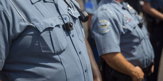 FERGUSON, MO - AUGUST 30: Members of the Ferguson Police department wear body cameras during a rally August 30, 2014 in Fergu