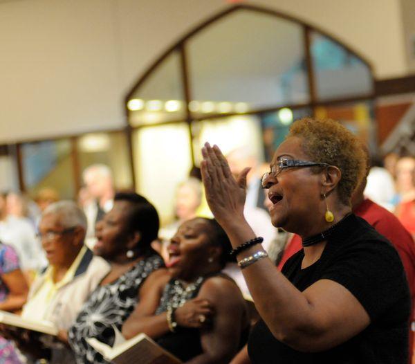 Betty Maddox, of Conyers, Ga., sings at the interfaith prayer vigil at Ebenezer Baptist Church in Atlanta on Thursday, June 1
