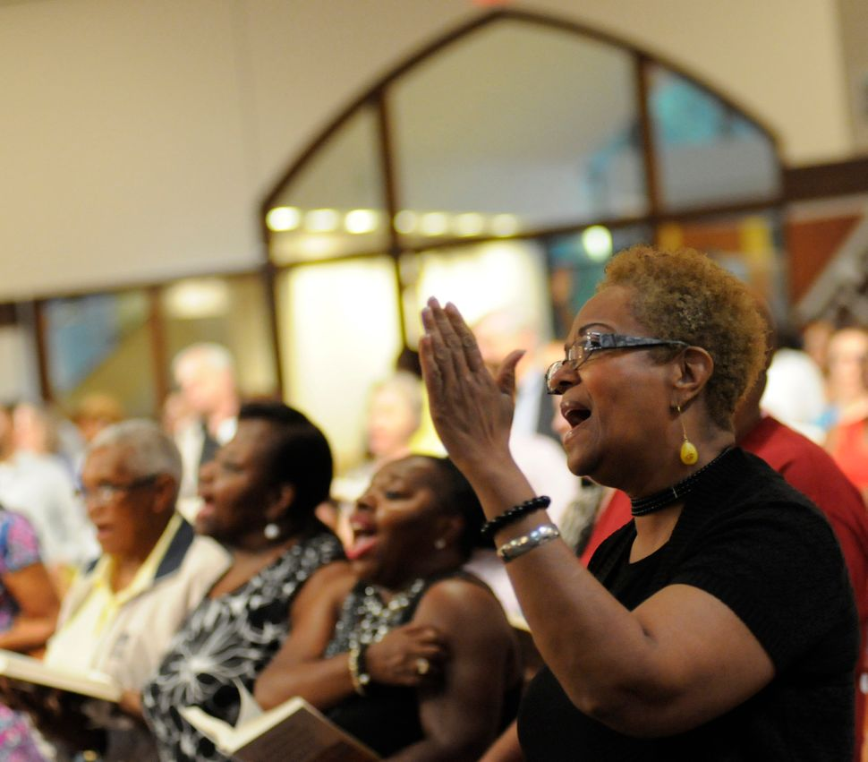 Betty Maddox, of Conyers, Ga., sings at the interfaith prayer vigil at Ebenezer Baptist Church in Atlanta on Thursday, June 1