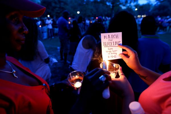Mourners gather at Marion Square for a candlelight vigil, Thursday, June 18, 2015,  near the Emanuel AME Church in Charleston
