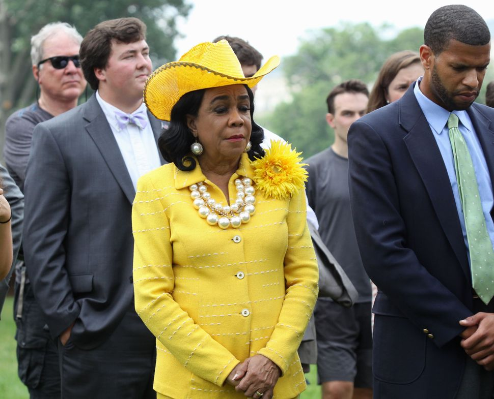Rep. Frederica Wilson, D-Fla., and other members of Congress,  attends a prayer vigil on Capitol Hill in Washington, Thursday