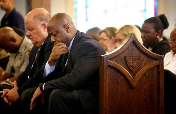 U.S. Sen. Tim  Scott bows his head in prayer during a prayer vigil held at Morris Brown AME Church in NYC for the victims of