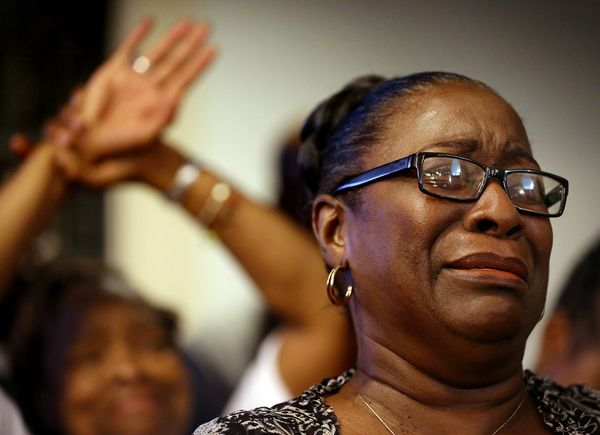 Rev. Jeannie Smalls cries during a prayer vigil held at Morris Brown AME Church in New York City for the victims of Wednesday
