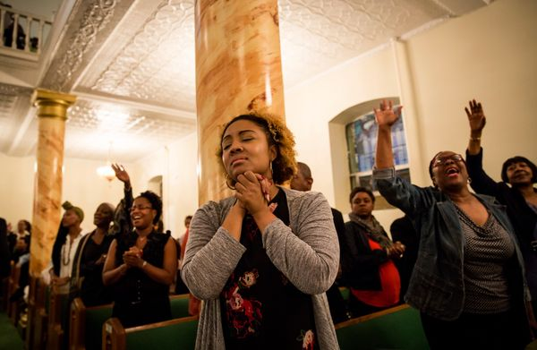 Mourners hold a prayer vigil for the nine victims of last night's shooting at the historic Emanuel African Methodist Episcopa