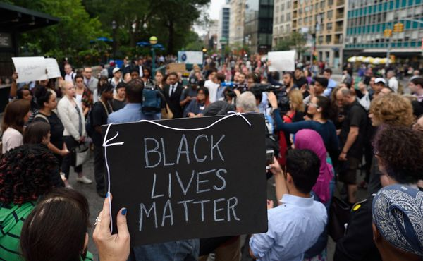 Mourners gather in Union Square Park June 18, 2015 in New York in to remember those killed at a prayer meeting in Charleston,
