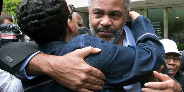 FILE - In this April 3, 2015 file photo, Pat Turner, left, hugs Anthony Ray Hinton as he leaves the Jefferson County jail in