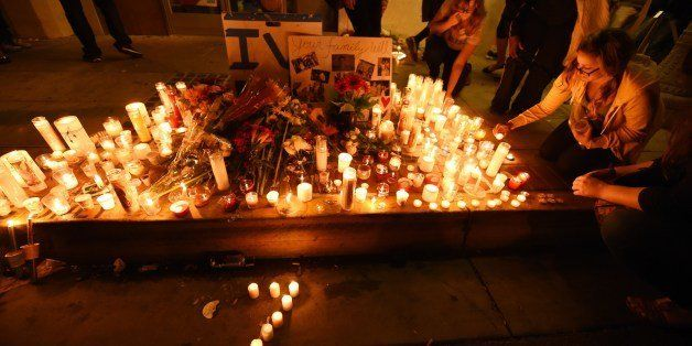 Candles in the shape of a number '7' for the seven dead - six victims and the shooter - in a killing rampage May 24, 2014 are