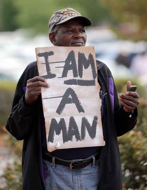 Robert Jackson holds a sign during a protest in shooting death of Walter Scott at city hall in North Charleston, S.C., Wednes