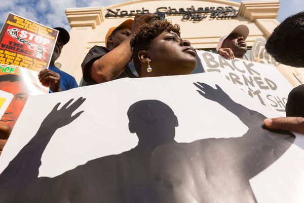 People participate in a rally to protest the death of Walter Scott, who was killed by police in a shooting, outside City Hall
