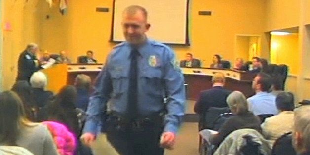In this  Feb. 11, 2014 image from video released by the City of Ferguson, Mo., officer Darren Wilson attends a city council m