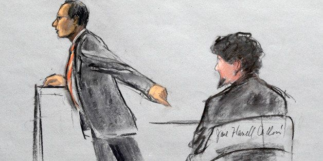 In this courtroom sketch, Assistant U.S. Attorney Aloke Chakravarty is depicted pointing to defendant Dzhokhar Tsarnaev, righ