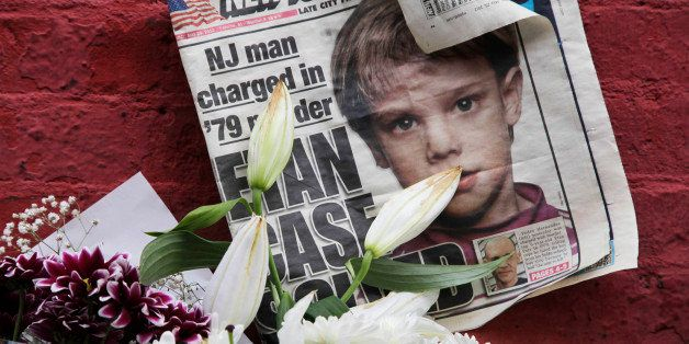 FILE - This May 28, 2012, file photo shows a newspaper with a photograph of Etan Patz that is part of a makeshift memorial in