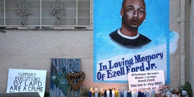 LOS ANGELES, CA - DECEMBER 05 :  Candles burn at a memorial for Ezell Ford in Los Angeles as protestors demonstrate as people