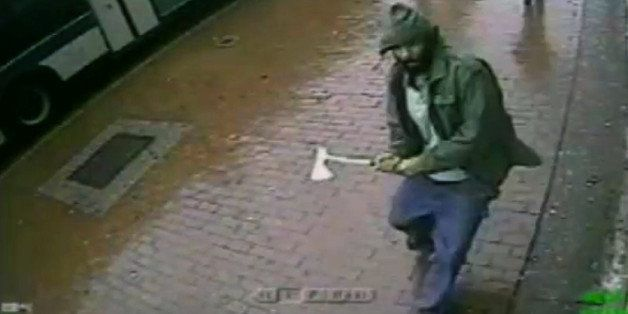In this frame grab taken from video provided by the New York Police Department, an unidentified man approaches New York City