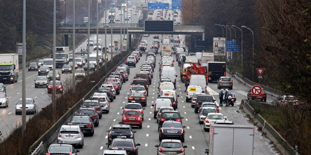 Taxis block and slow down traffic on the northern highway leading to Paris, Monday Dec. 15, 2014. Several hundred taxis block