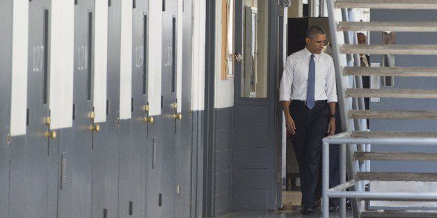 US President Barack Obama tours a cell block at the El Reno Federal Correctional Institution in El Reno, Oklahoma, July 16, 2