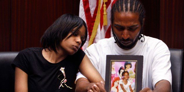 FILE - In this May 18, 2010, file photo Dominika Stanley, left, the mother of 7-year-old Aiyana Jones, sits next to Aiyana's