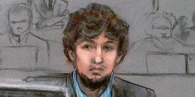 In this courtroom sketch, Dzhokhar Tsarnaev, right, and defense attorney Judy Clarke are depicted watching evidence displayed