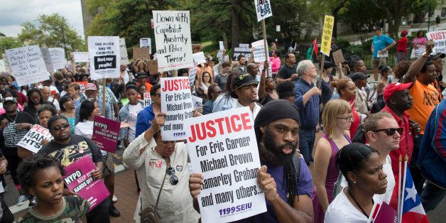 FILE - Demonstrators march to protest the death of Eric Garner, Saturday, Aug. 23, 2014, in the Staten Island borough of New York. Amid the fallout from a grand jury's decision in the fatal police shooting of Michael Brown in Missouri, a panel in New York City is quietly nearing its own conclusion about another combustible case involving the death of an unarmed man at the hands of police. (AP Photo/John Minchillo, File)
