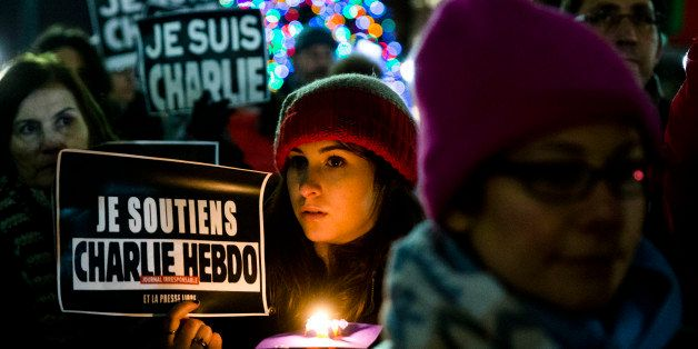 People gather to pay to pay tribute to victims of the terrorist attack against the French satirical weekly Charlie Hebdo, Fri