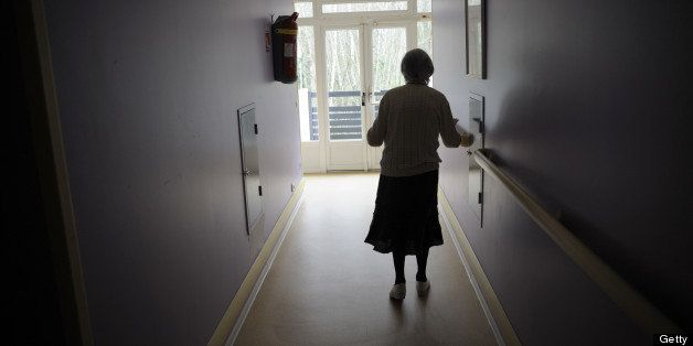 A woman, suffering from Alzheimer's desease, walks in a corridor on March 18, 2011 in a retirement house in Angervilliers, ea