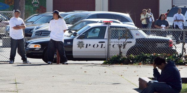 RICHMOND, CA - NOVEMBER 02:  Students walk by Richmond, California police car that is parked in front of Richmond High School