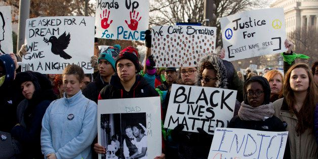 Demonstrators march on Pennsylvania Avenue toward Capitol Hill in Washington, Saturday, Dec. 13, 2014, during the Justice for
