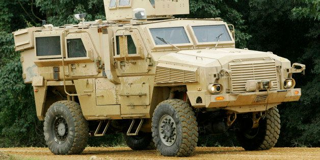 ** FILE ** A Category I mine-resistant ambush-protected (MRAP) vehicle, is driven on a test course during a media demonstrati