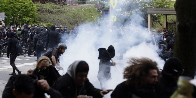 Police and protesters clash during a May Day march Friday, May 1, 2015, in downtown Seattle. (AP Photo/Ted S. Warren)