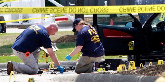 GARLAND, TX - MAY 4:  Investigators work a crime scene outside of the Curtis Culwell Center after a shooting occurred the day