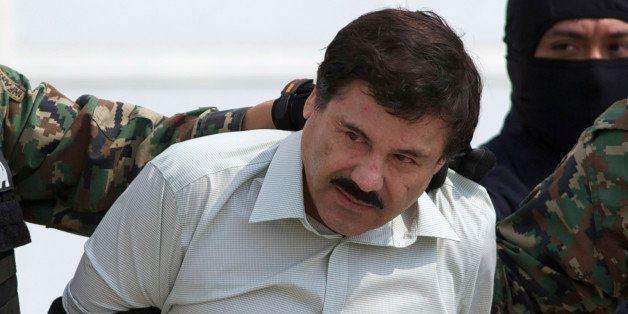 "FILE - This Feb. 22, 2014 file photo shows Joaquin ""El Chapo"" Guzman, the head of Mexicoᅢ까タᅡルs Sinaloa Cartel, being escorte"