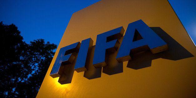 ZURICH, SWITZERLAND - JUNE 02: A FIFA logo sits on a sign at the FIFA headquarters on June 2, 2015 in Zurich, Switzerland. Jo