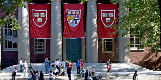 UNITED STATES - SEPTEMBER 03:  Harvard banners hang outside Memorial Church on the Harvard University campus in Cambridge, Ma