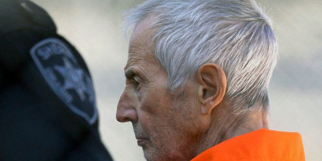 FILE - In this Tuesday, March 17, 2015, file photo, Robert Durst is escorted into Orleans Parish Prison after his arraignment