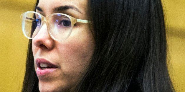 Jodi Arias looks at her attorney in Maricopa County Superior Court in Phoenix, Friday, Nov. 21, 2014, during the sentencing p
