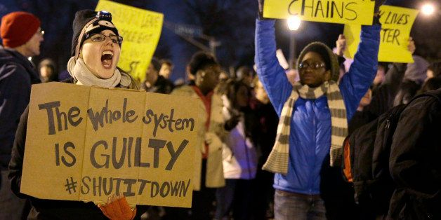 Protesters block streets after the announcement of the grand jury decision, Monday, Nov. 24, 2014, in St. Louis, Mo. A grand