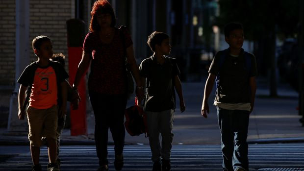 Children are escorted to the Cayuga Center, which provides foster care and other services to immigrant children separated from their families, in New York City, U.S., July 10, 2018. REUTERS/Brendan McDermid