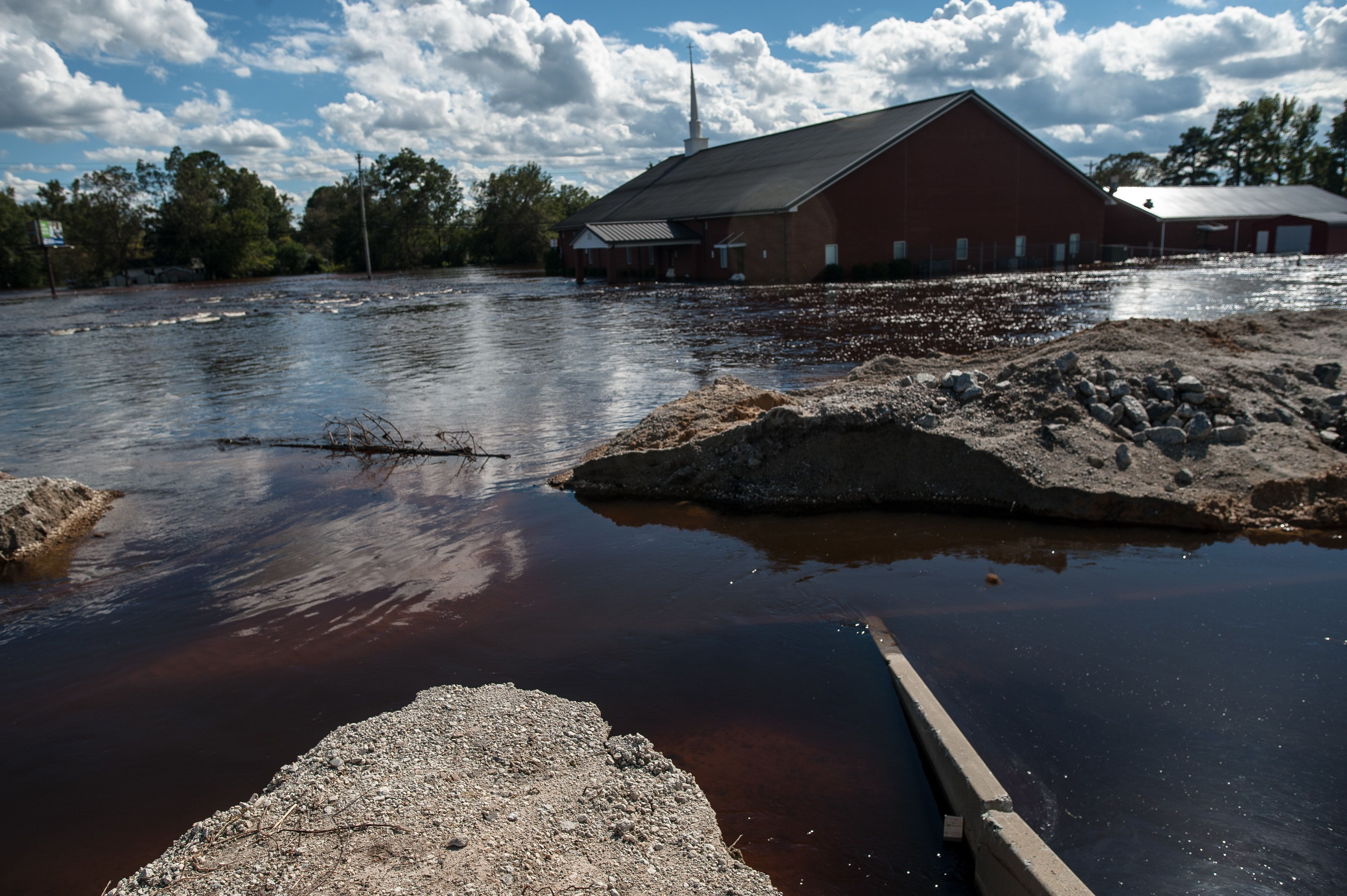 One of the two breaks in the temporary dirt and sandbag levee in Lumberton that failed on Sunday.