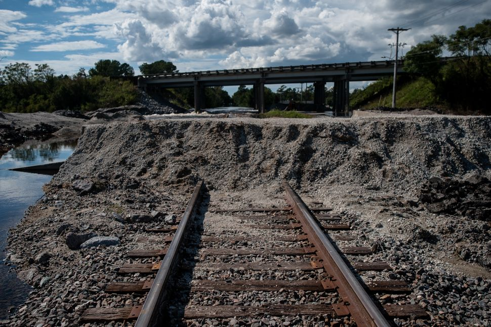 A temporary levee of dirt, gravel and sandbags was built over the railroad track in Lumberton over the weekend in an attempt
