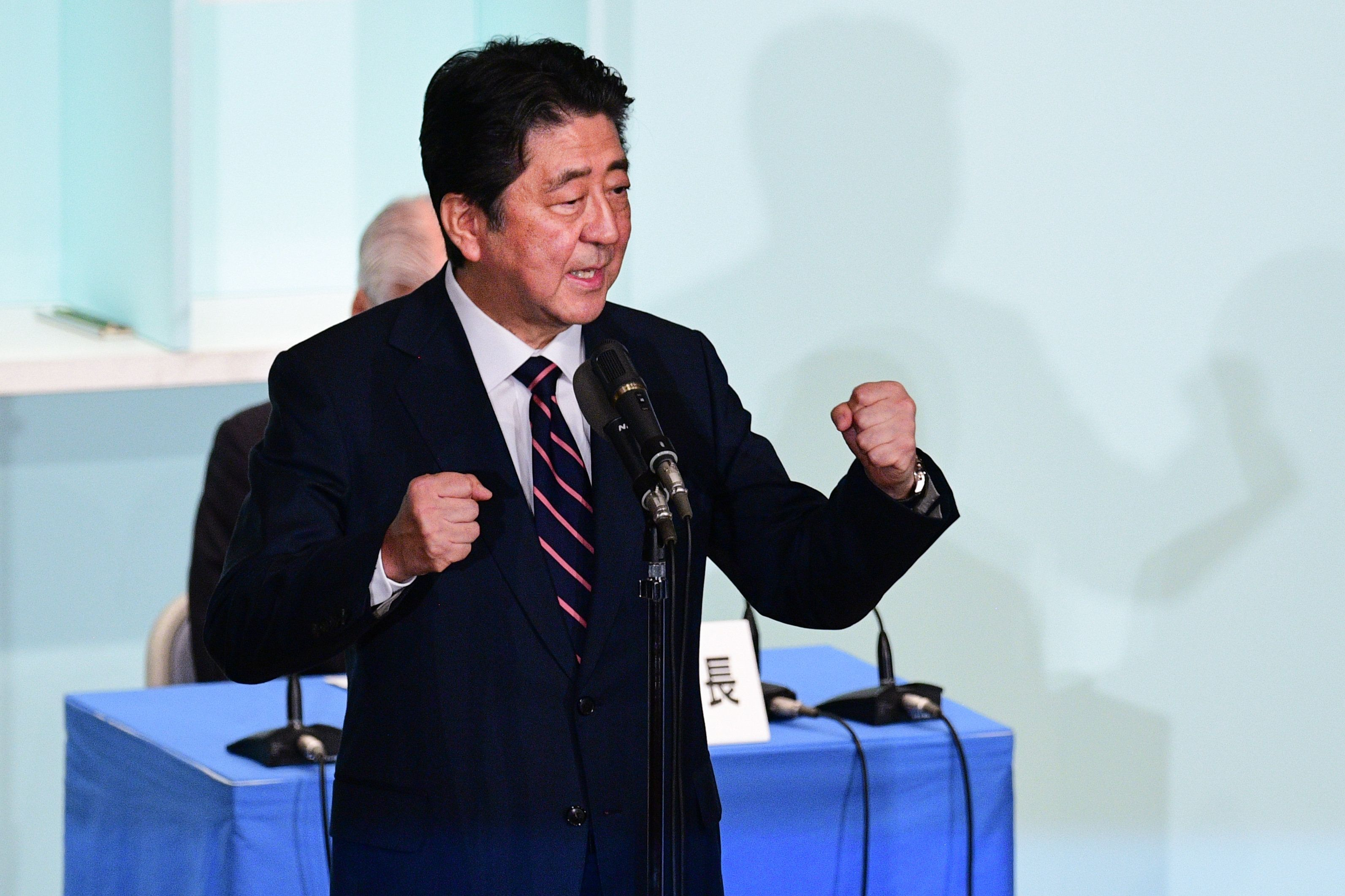 Japan's Prime Minister Shinzo Abe delivers a speech during the ruling liberal Democratic Party (LDP) leadership election at the party's headquarters in Tokyo on September 20, 2018. - Prime Minister Shinzo Abe won re-election as leader of his ruling party on September 20, setting him on course to become Japan's longest-serving premier and realise his dream of reforming the constitution. (Photo by Martin BUREAU / AFP)        (Photo credit should read MARTIN BUREAU/AFP/Getty Images)