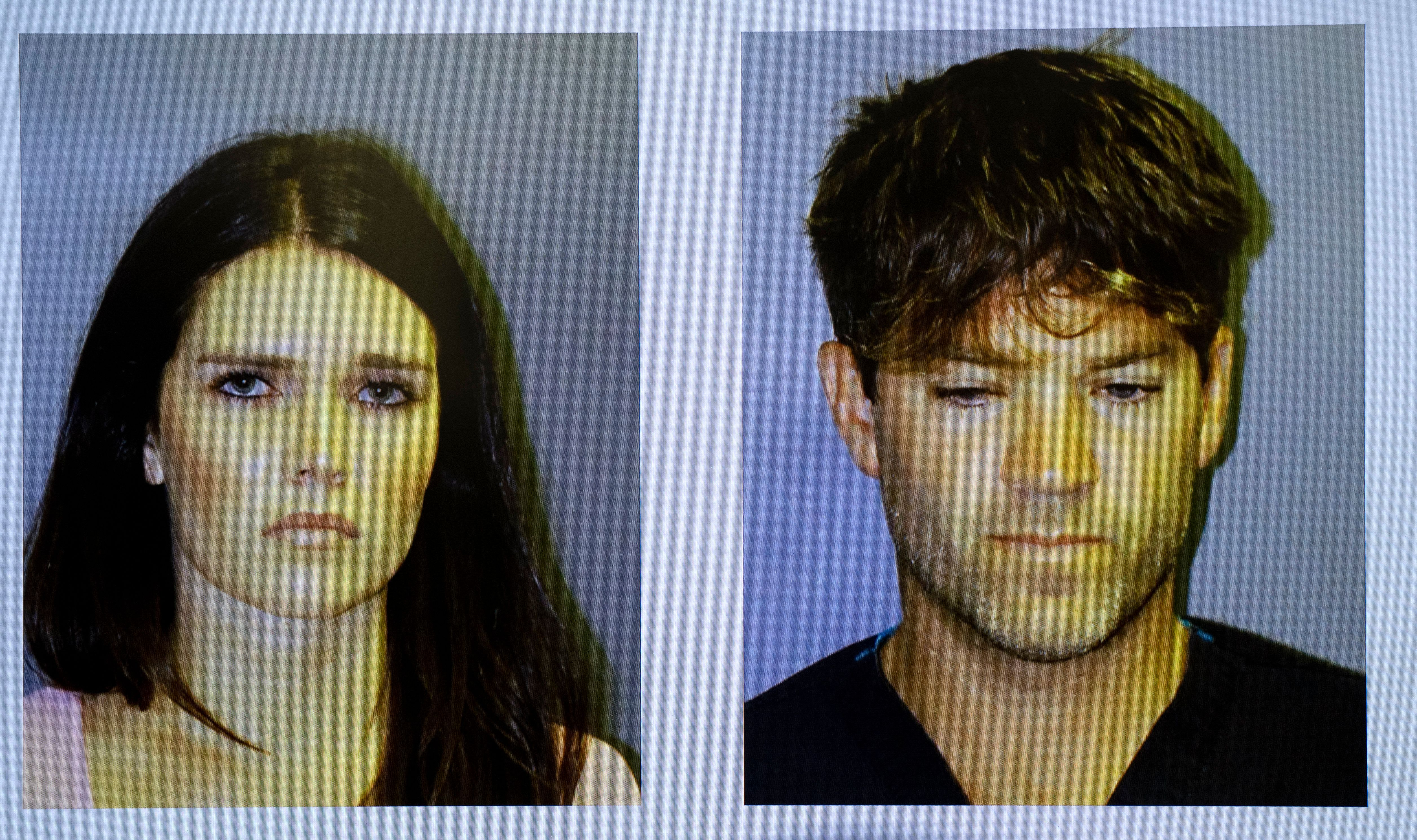 SANTA ANA, CA - SEPTEMBER 17: Booking mugs of Cerissa Laura Riley, 31, and surgeon Grant William Robicheaux, 38, are projected on a screen during a press conference in Santa Ana on Tuesday, September 18, 2018. The Orange County District Attorney announced that the couple is being charged with sexually assaulting two women by use of drugs and want other possible victims to come forward  (Photo by Mindy Schauer/Digital First Media/Orange County Register via Getty Images)